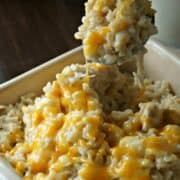 Creamy and Cheesy Chicken and Rice in yellow casserole dish