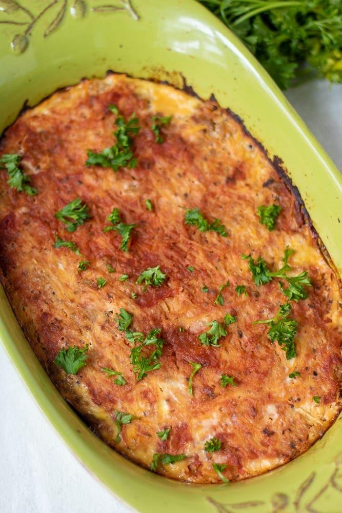 Paleo Spaghetti Squash Casserole in green baking dish
