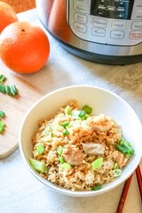 Gluten Free Instant Pot Orange Chicken with Rice: In 15 minutes, rice and chicken cook together in a bright and tangy orange sauce that is better than take-out.