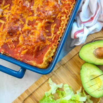 Taco Lasgana: Your favorite taco dip turned into a hearty lasagna ready to be topped with all your favorite Tex-Mex toppings.