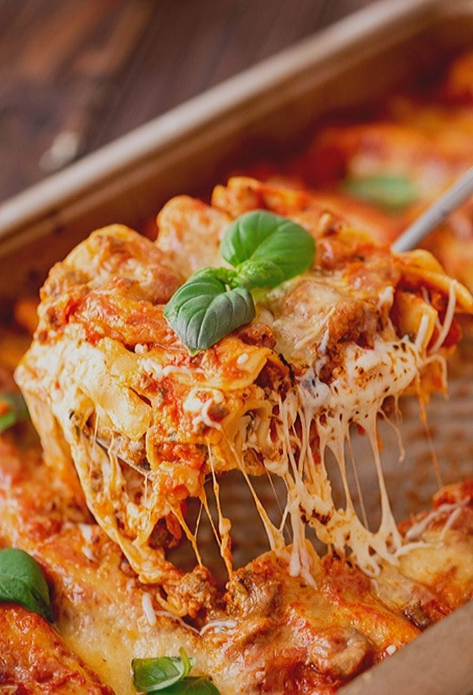 Easy Homemade Lasagna Being Pulled out of Pan