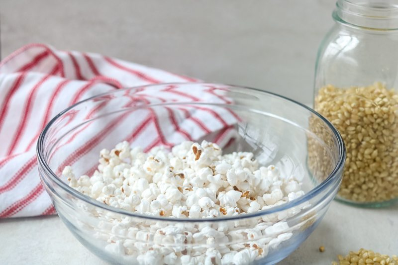homemade microwave popcorn popped in glass bowl