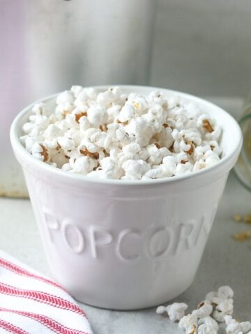 Popcorn in white bowl labeled popcorn