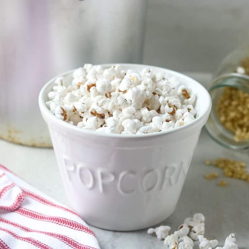 Popcorn in white bowl labeled popcorn