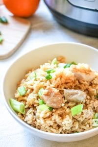 Instant Pot Orange Chicken with Rice: In 15 minutes, rice and chicken cook together in a bright and tangy orange sauce that is better than take-out.