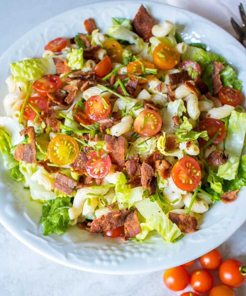 BLT pasta salad in white serving bowl.