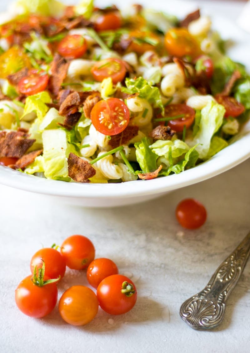 Pasta tossed with bacon, tomatoes and lettuce