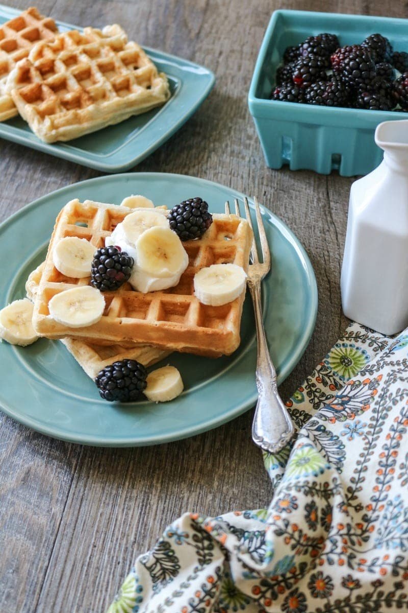 Homemade Whole Wheat Waffles on blue plate topped with fruit