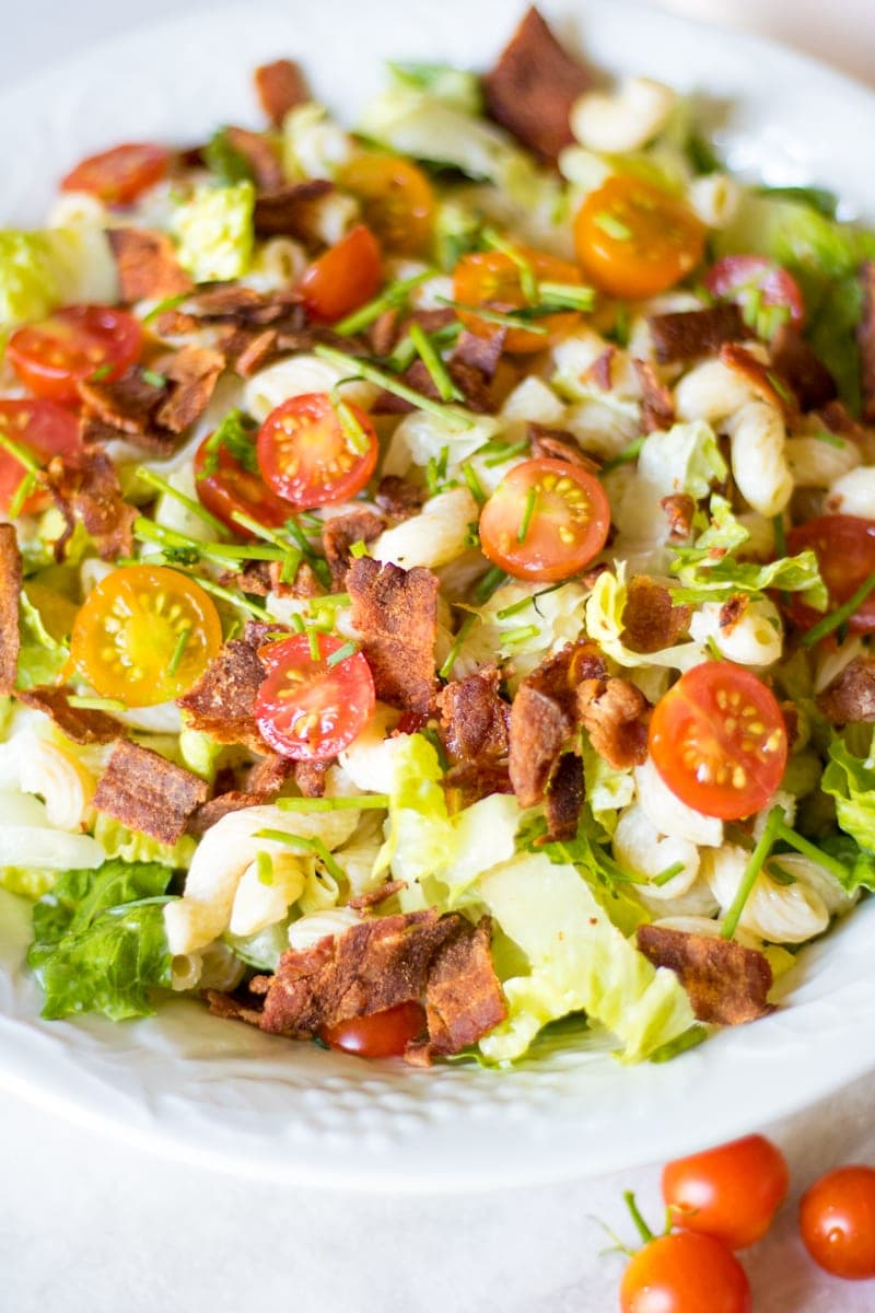 BLT Pasta Salad: Bacon, sweet summer tomatoes, and crisp lettuce are tossed with tender pasta that has been coated with a rich dressing for a perfect spin on a classic BLT sandwich.