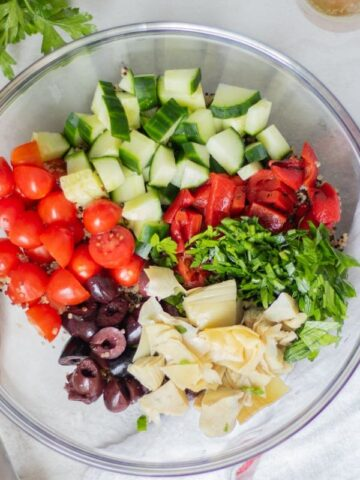 Ingredients for Greek Quinoa Salad in Mixing bowl
