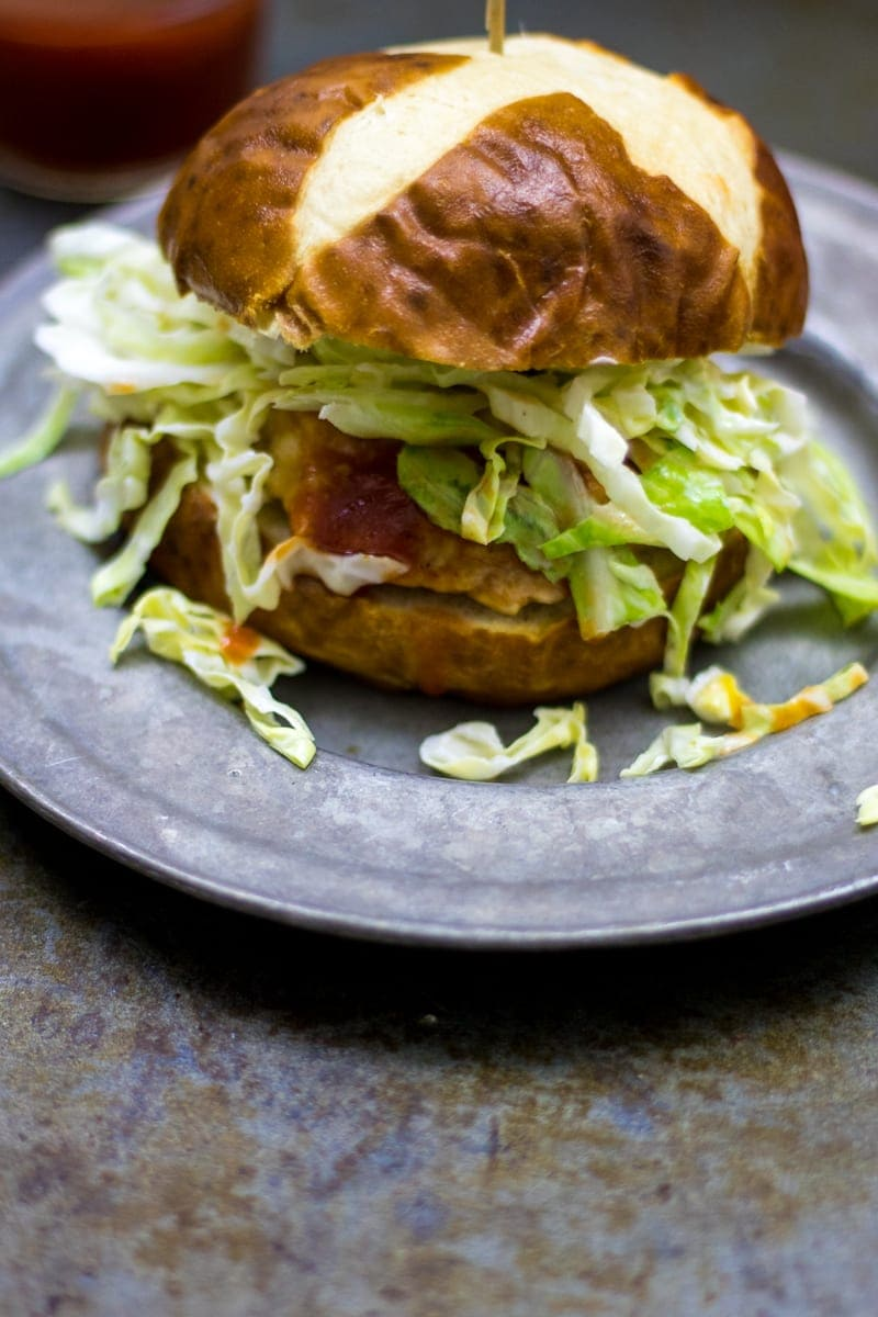 Barbeque Chicken Burger with Coleslaw: A hand-made chicken patty is seasoned with barbeque flavors and stuffed with cheddar cheese and topped with slaw.