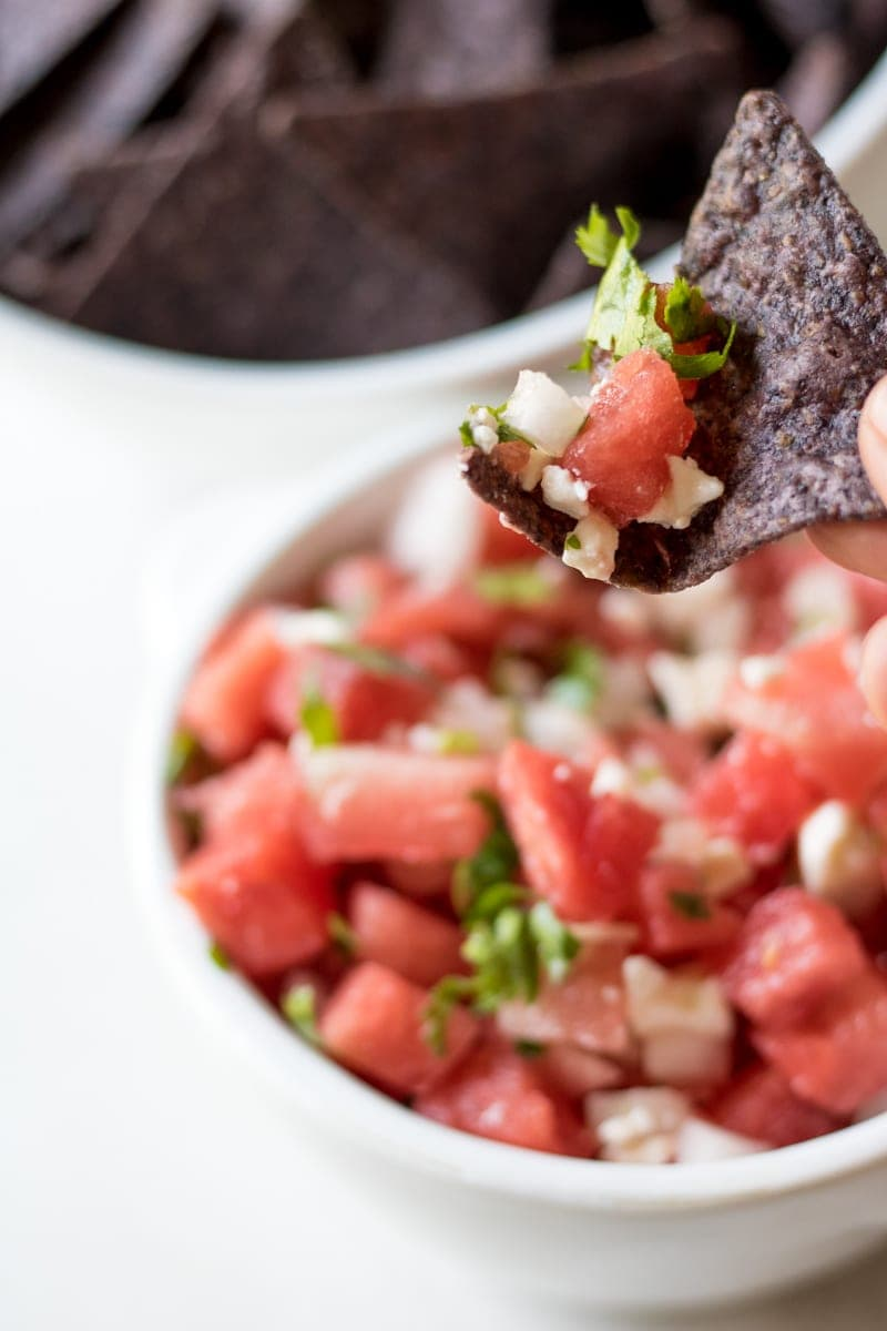 Watermelon Salsa: Watermelon is tossed with bright lime juice, fresh cilantro and salty feta for a perfect summer salsa. Pair with Blue Corn Chips for a festive red, white and blue appetizer.