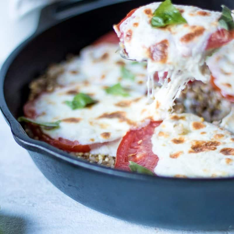 Mozzarella Tomato Quinoa Bake: Seasoned quinoa is baked with vine-ripened tomatoes and fresh mozzarella for a simple vegetarian and gluten-free summer meal.