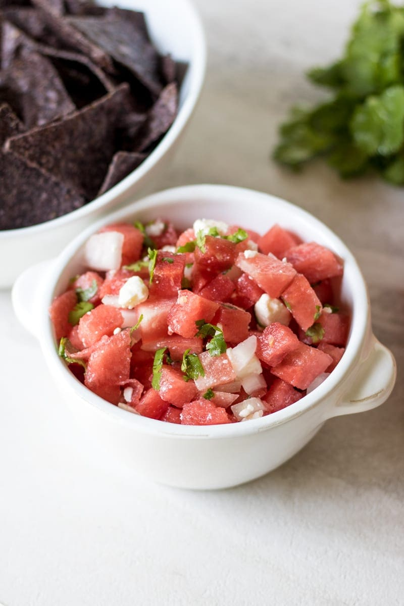 Watermelon Salsa with cilantro in white bowl