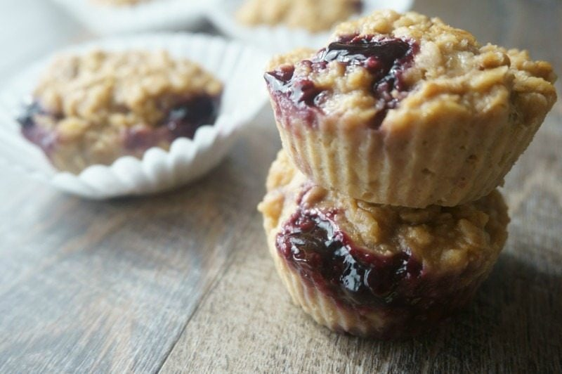 3 Baked Peanut Butter and Jelly Baked Oatmeal Muffins on table