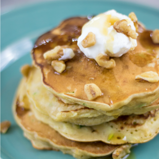Zucchini Pancakes topped with Greek yogurt, maple syrup and toasted walnuts. It is like dessert for breakfast.
