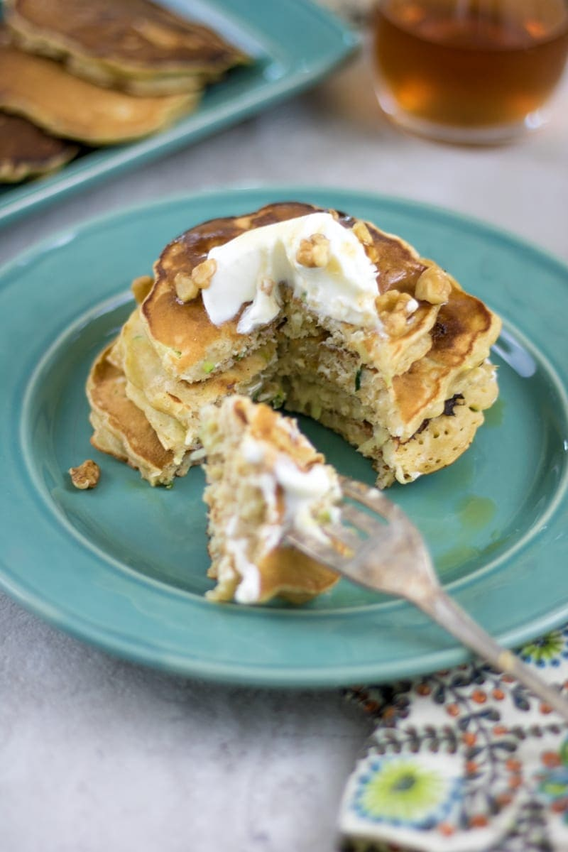 Zucchini Bread Pancakes with yogurt and crushed nuts