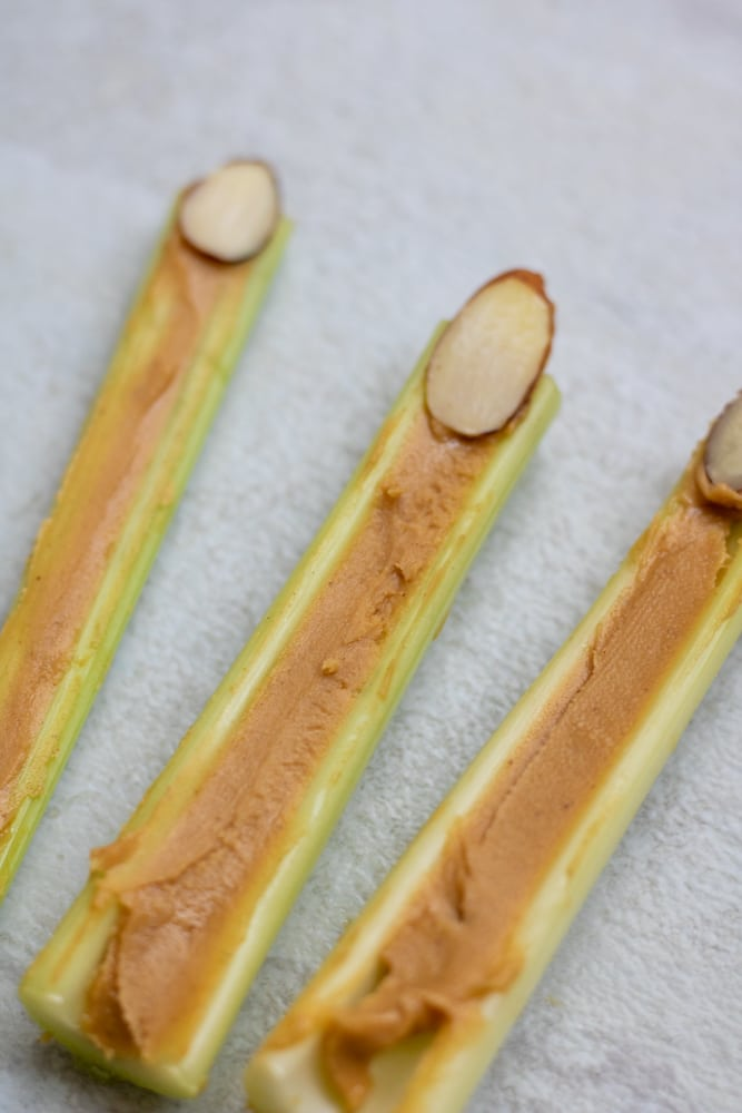 Celery Sticks with Peanut Butter and Almond Slices