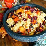 quinoa salad in wooden bowl with roasted butternut squash and cranberries