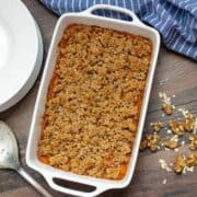Healthy Sweet Potato Casserole baked in white dish
