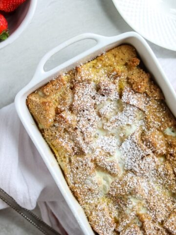 Eggnog French Toast Casserole in white baking dish.