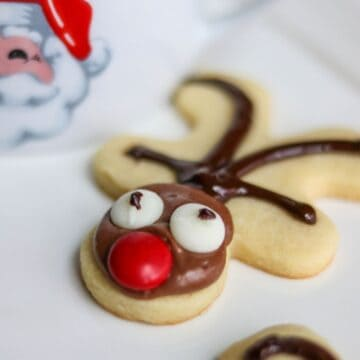 Reindeer Sugar Cookie next to santa mug.