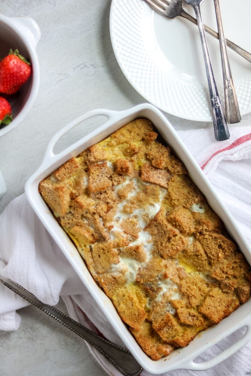 Easy Overnight French Casserole in white dish with white plates and forks off to the side.
