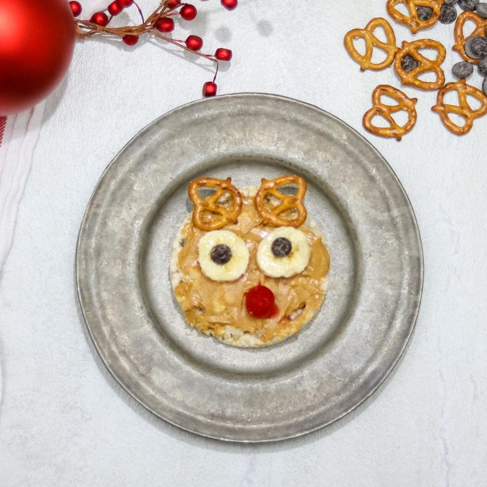Rudolph the Reindeer Rice Cake: A rice cake topped with nut spread and fun decorations to bring this reindeer to life.