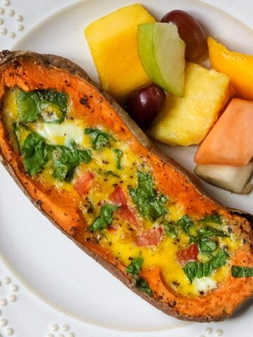 Baked Spinach Omelet in Baked Sweet Potato next to mixed Fruit