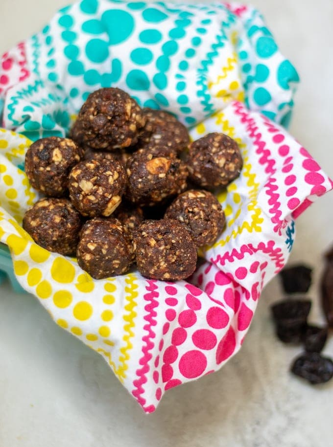 Colorful Napkin with Date Protein Balls stacked on top
