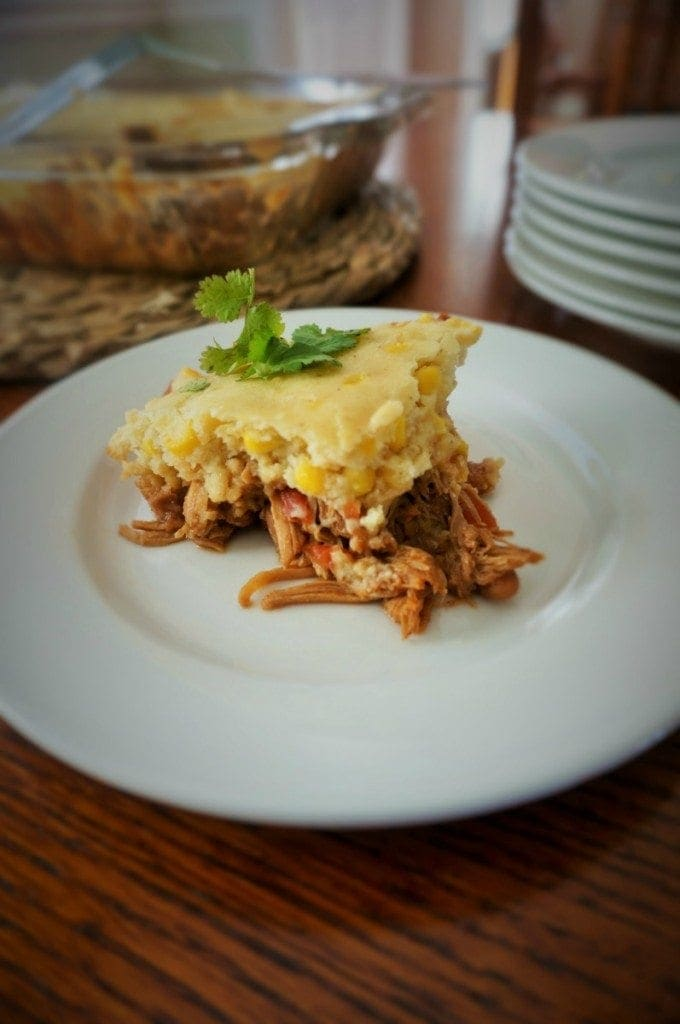 Tamale Pie: A hearty casserole filled with shredded seasoned meat and topped with a homemade cornbread that is captures the flavors of a tamale without all the work.