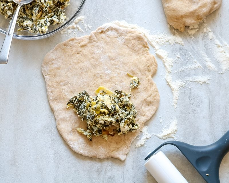 Spinach Artichoke mixture on top of calzone dough