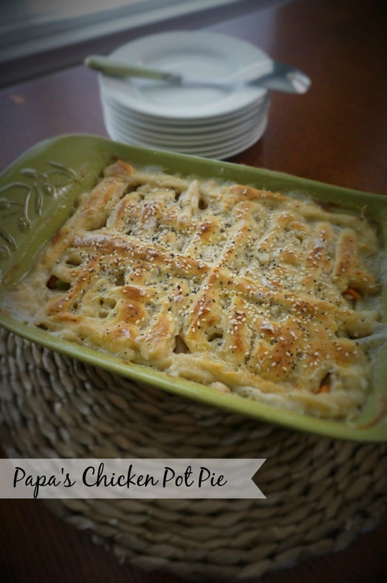 Homemade Chicken Pot Pie: Tender chicken and vegetables swim together in a creamy sauce that is adorned with a flaky homemade biscuit crust.
