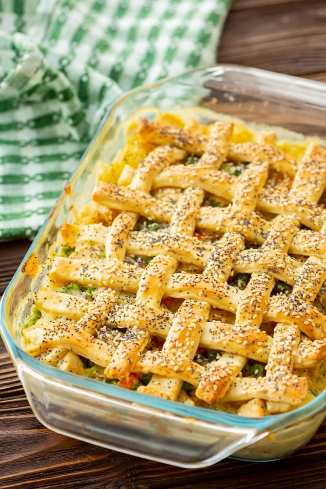 Baked Chicken Pot Pie with lattice biscuit topping in glass dish