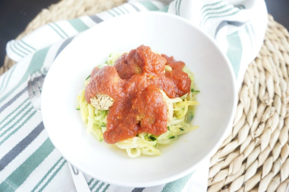 "You have never seen spaghetti and meatballs like this! Tender, spicy lentil meatballs are perfectly paired with fresh garlic zucchini ""noodles"" and homemade marinara, creating a spin on a classic comfort dish that is usually rich in carbs and fat. This is one vegan meal that will even please the meat-eaters!"
