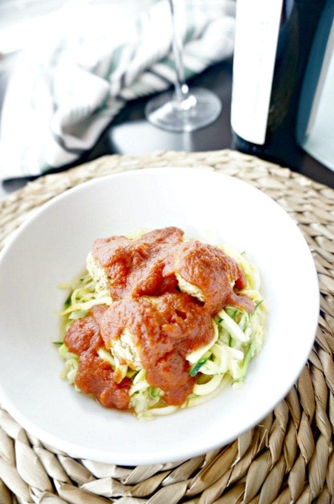 """You have never seen spaghetti and meatballs like this! Tender, spicy lentil meatballs are perfectly paired with fresh garlic zucchini """"noodles"""" and homemade marinara, creating a spin on a classic comfort dish that is usually rich in carbs and fat. This is one vegan meal that will even please the meat-eaters!"""
