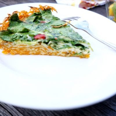 Whole 30 Sweet Potato Quiche: Shredded sweet potatoes create the base for a roasted red pepper and fresh spinach quiche, making this dish gluten-free, paleo, vegetarian, and delicious! Perfect for Easter brunch or a light dinner.