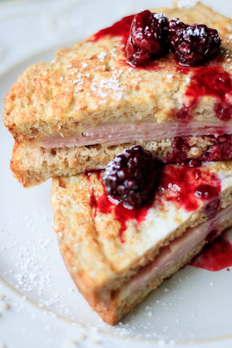 Monte Cristo with Fresh Blackberry Sauce: A gussied up version of a grilled cheese sandwich is a Monte Cristo, or a fried ham and cheese sandwich. But this is not just any Monte Cristo--this one has been dipped in a french toast batter and then topped with a fresh blackberry syrup.
