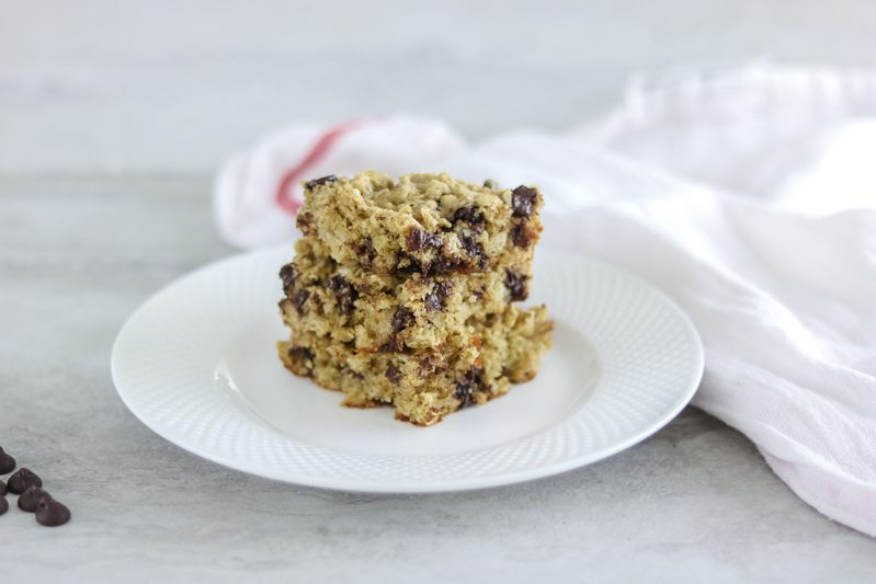 3 Oatmeal chocolate chip bars stacked on a white plate