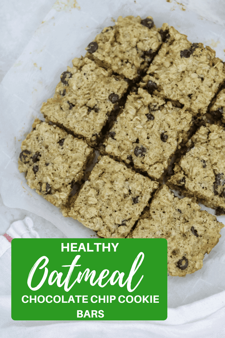 Healthy Oatmeal Chocolate Chip Cookie Bars taste every bit as decadent as a traditional bar cookie. These bars have been given a healthy update with Greek yogurt, coconut oil, dark chocolate, whole wheat, and are naturally sweetened. #chocolatechipcookies #cookies #barcookies #healthycookies #healthybaking #naturallysweetened