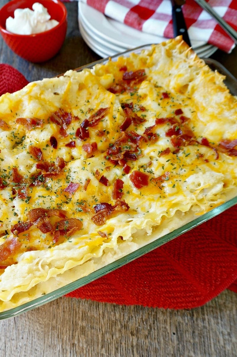 Creamy mashed potatoes and cheese are layered in between lasagna noodles to create Pierogi Lasagna--a carb lover's dream come true.