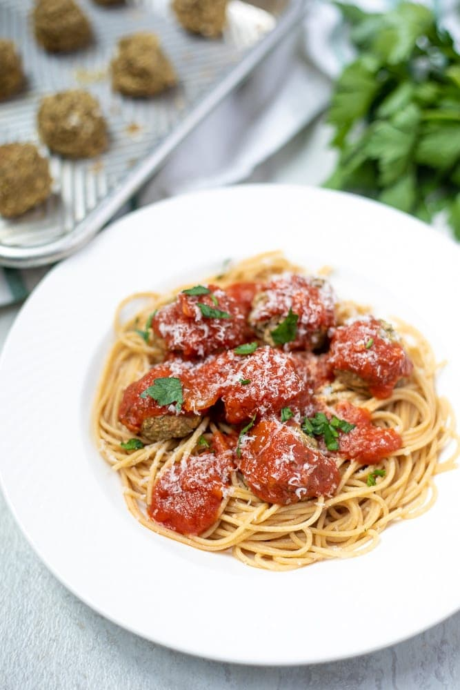 Bowl of spaghetti topped with lentil meatballs and marinara
