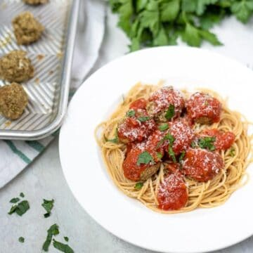 Lentil Meatballs served with pasta on a white plate