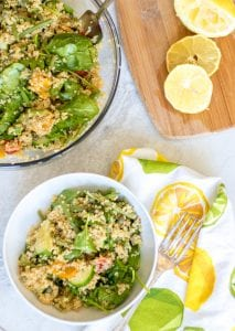 Spinach and Lemon Quinoa Salad: A light and refreshing quinoa salad served over spinach with a fresh lemon dressing. Vegan. Gluten-Free.