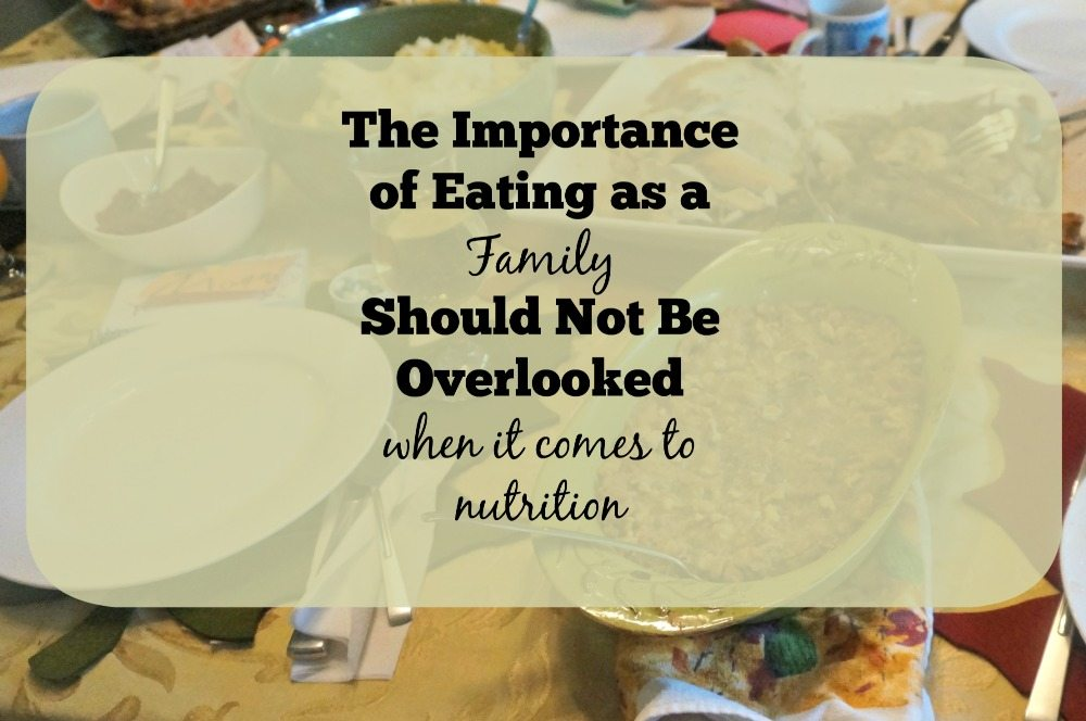 Text overlay on dinner table that reads The Importance of family dinner should not be overlooked when it comes to nutrition.