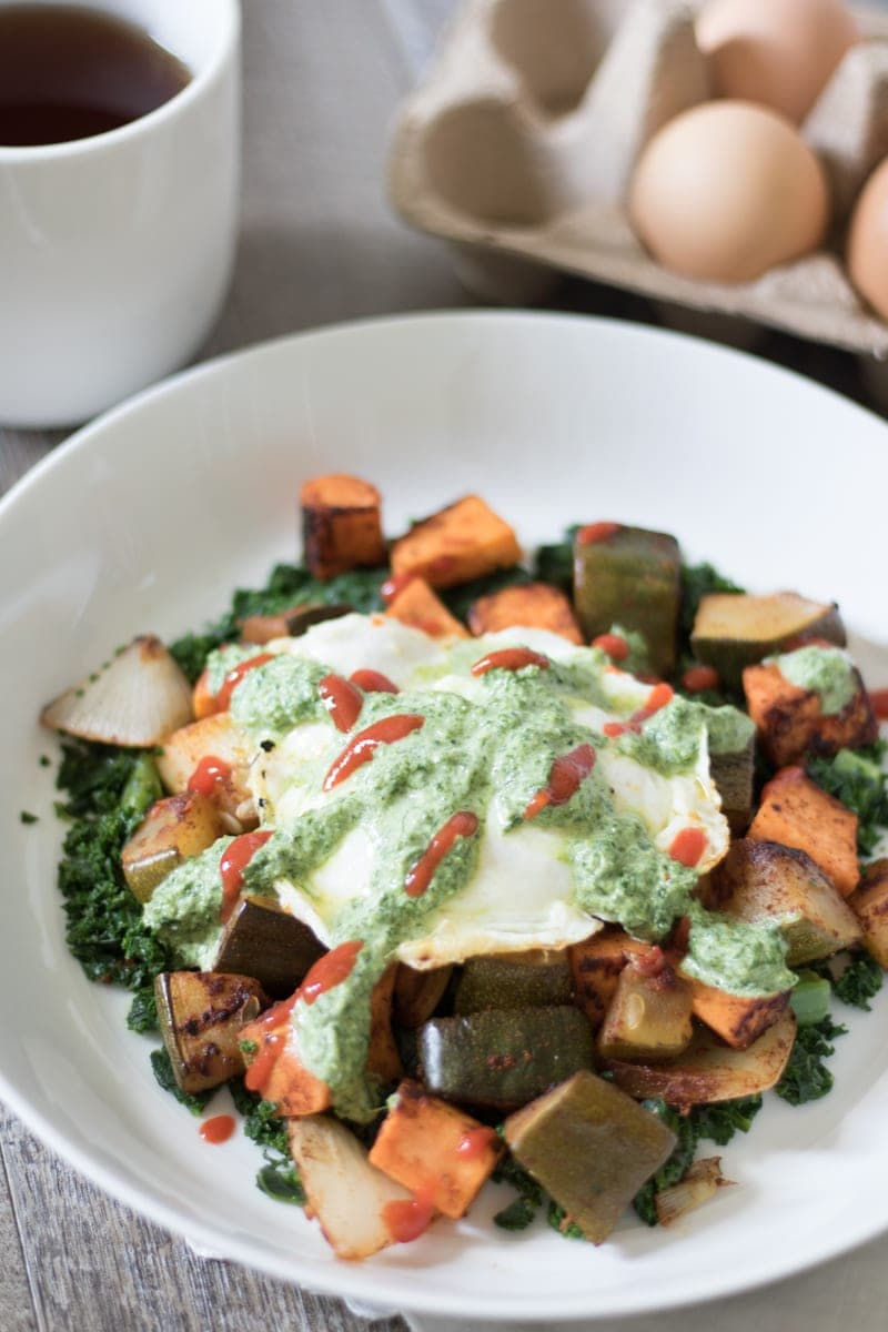 Sweet Potato Hash topped with a fried egg and cilantro pesto.