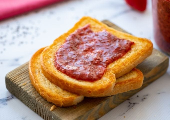 Toasted Bread with spread with strawberry jam