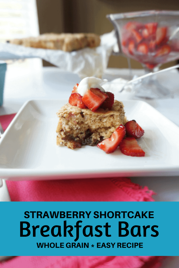 Strawberry Shortcake Breakfast Bars: Soft and sweet, these Strawberry Shortcake Breakfast Bars are packed full of whole grains, protein, fiber and antioxidants; not to mention a little dark chocolate.  These jam bars are sure to start your day with a smile.#shortcake #chocolate #strawberryshortcake #healthydessertrecipe #brunch #breakfastbar #amindfullmom
