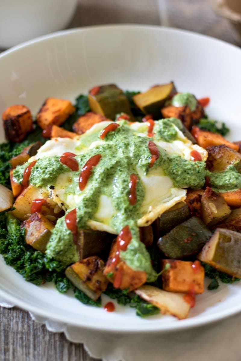 Southwestern Sweet Potato Hash with Cilantro Pesto: A traditional hash, spiced up with smoked chipolte and finished off with a poached egg and fresh cilantro pesto. Perfect for breakfast, brunch, lunch, or dinner. Paleo. Gluten-Free. Dairy-Free