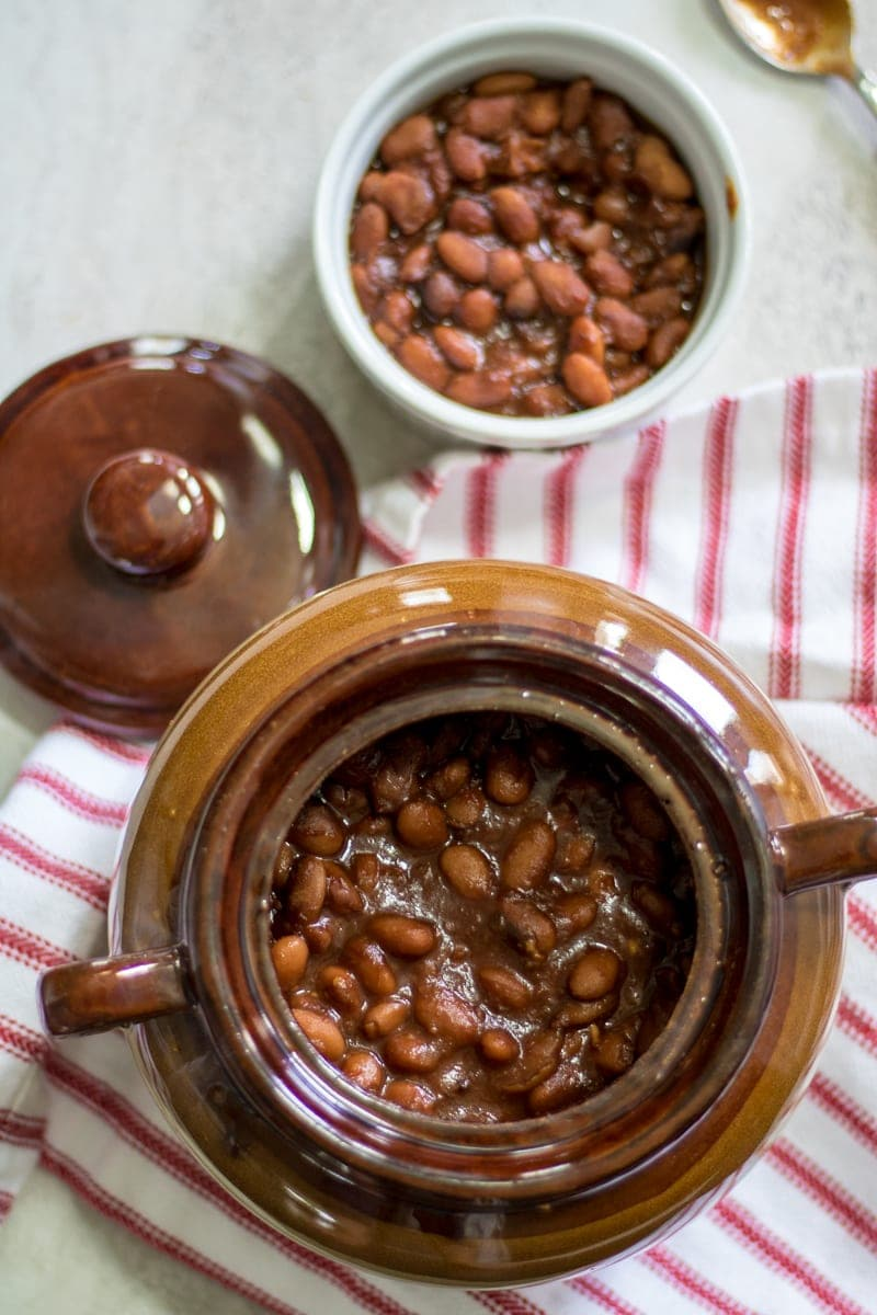 Slow cooked pinto beans with a homemade sweet and smokey sauce. A family heirloom recipe for the best baked beans that you have ever tasted--no cans here!